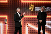 (L-R) Steve Coogan accepts the Charlie Chaplin Britannia Award for Excellence in Comedy Presented by Jaguar Land Rover as John C. Reilly looks on onstage during the 2019 British Academy Britannia Awards presented by American Airlines and Jaguar Land Rover at The Beverly Hilton Hotel on October 25, 2019 in Beverly Hills, California.