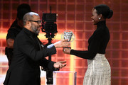(L-R) Jordan Peele accepts the John Schlesinger Britannia Award for Excellence in Directing Presented by Cunard from Lupita Nyong'o onstage during the 2019 British Academy Britannia Awards presented by American Airlines and Jaguar Land Rover at The Beverly Hilton Hotel on October 25, 2019 in Beverly Hills, California.