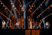 (EDITORIAL USE ONLY) Karen Fairchild, Jimi Westbrook, Kimberly Schlapman and Philip Sweet of Little Big Town perform on stage during day 2 for the 2019 CMA Music Festival on June 07, 2019 in Nashville, Tennessee.