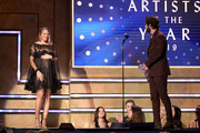 Lauren Akins presents an award to Thomas Rhett during the 2019 CMT Artist of the Year at Schermerhorn Symphony Center on October 16, 2019 in Nashville, Tennessee.