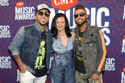 Chris Lucas and Preston Brust of LOCASH pose with Leslie Fram at the 2019 CMT Music Award at Bridgestone Arena on June 05, 2019 in Nashville, Tennessee.