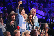 (L-R) Mark Wystrach of musical group Midland, Jimi Westbrook, Karen Fairchild and Phillip Sweet of musical group Little Big Town host the 2019 CMT Music Awards at Bridgestone Arena on June 05, 2019 in Nashville, Tennessee.