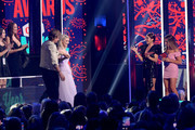 Sarah Hyland and Jessie James Decker present an award to Julia Michaels and Keith Urban onstage at the 2019 CMT Music Awards at Bridgestone Arena on June 05, 2019 in Nashville, Tennessee.