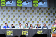 .(L-R) Hartley Sawyer, Danielle Panabaker, Tom Cavanagh, Grant Gustin, Candice Patton, Carlos Valdes, Eric Wallace and Laura Prudom speak at 'The Flash' Special Video Presentation and Q&A during 2019 Comic-Con International at San Diego Convention Center on July 20, 2019 in San Diego, California.