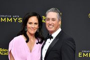 Annabeth Gish and Wade Allen attend the 2019 Creative Arts Emmy Awards on September 15, 2019 in Los Angeles, California.