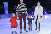 """(L-R) Harper Grace Hammer, Armie Hammer, Ford Armand Douglas Hammer, and Elizabeth Chambers pose for portrait at 2019 Disney On Ice """"Mickey's Search Party"""" at Staples Center on December 13, 2019 in Los Angeles, California."""