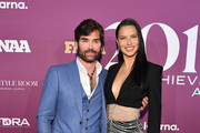 Michael Atmore and Adriana Lima attend 2019 FN Achievement Awards at IAC Building on December 03, 2019 in New York City.