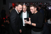 Gus Kenworthy (L) and guests attend the 2019 GQ Men of the Year After Party Presented By Samsung  at The West Hollywood EDITION on December 05, 2019 in West Hollywood, California.