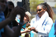 Serena Williams of the United States signs autographs after practicing during day two of the 2019 Hopman Cup at RAC Arena on December 30, 2018 in Perth, Australia.