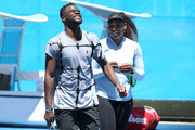 Frances Tiafoe and Serena Williams of the United States share a moment on the practice court during day two of the 2019 Hopman Cup at RAC Arena on December 30, 2018 in Perth, Australia.