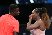 Serena Williams and Frances Tiafoe of the United States talk tactics in the mixed doubles match against Maria Sakkari and TS during day three of the 2019 Hopman Cup at RAC Arena on December 31, 2018 in Perth, Australia.