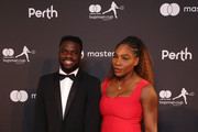 Frances Tiafoe and Serena Williams of the United States pose on the black carpet at the Hopman Cup New Years Eve Gala dinner during day three of the 2019 Hopman Cup at RAC Arena on December 31, 2018 in Perth, Australia.