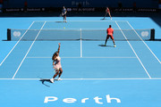 Serena Williams of the United States serves in the mixed doubles match against Katie Boulter and Cameron Norrie of Great Britain during day six of the 2019 Hopman Cup at RAC Arena on January 03, 2019 in Perth, Australia.