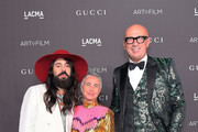 (L-R) Alessandro Michele, wearing Gucci, Maristella Levoni, and Marco Bizzarri attend the 2019 LACMA Art + Film Gala Presented By Gucci at LACMA on November 02, 2019 in Los Angeles, California.