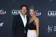 Actors Jamie Bamber (L), and Tricia Helfer attend the 2019 Los Angeles Latino International Film Festival - Opening Night Premiere of 'The Infiltrators' at TCL Chinese Theatre on July 31, 2019 in Hollywood, California.