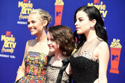 (L-R) Madison Iseman, Mckenna Grace, and Katie Sarife attend the 2019 MTV Movie and TV Awards at Barker Hangar on June 15, 2019 in Santa Monica, California.