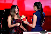 (L-R) Sandra Bullock and Gal Gadot speak onstage during the 2019 MTV Movie and TV Awards at Barker Hangar on June 15, 2019 in Santa Monica, California.