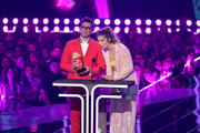 (L-R) Daniel Levy and Annie Murphy present an award onstage during the 2019 MTV Movie and TV Awards at Barker Hangar on June 15, 2019 in Santa Monica, California.