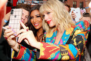 Taylor Swift takes a selfie with a fan during the 2019 MTV Video Music Awards at Prudential Center on August 26, 2019 in Newark, New Jersey.