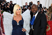 Kris Jenner and Corey Gamble attend The 2019 Met Gala Celebrating Camp: Notes on Fashion at Metropolitan Museum of Art on May 06, 2019 in New York City.
