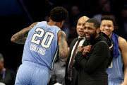 Kyrie Irving reacts with John Collins #20 of the U.S. Team during the 2019 Mtn Dew ICE Rising Stars at Spectrum Center on February 15, 2019 in Charlotte, North Carolina.