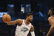 Paul George #13 of the Oklahoma City Thunder and Team Giannis drives against James Harden #13 of the Houston Rockets and Team LeBron during the NBA All-Star game as part of the 2019 NBA All-Star Weekend at Spectrum Center on February 17, 2019 in Charlotte, North Carolina. Team LeBron won 178-164. NOTE TO USER: User expressly acknowledges and agrees that, by downloading and/or using this photograph, user is consenting to the terms and conditions of the Getty Images License Agreement.