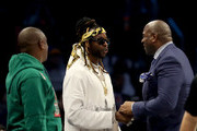 Magic Johnson greets 2 Chainz at halftime during the NBA All-Star game as part of the 2019 NBA All-Star Weekend at Spectrum Center on February 17, 2019 in Charlotte, North Carolina.  NOTE TO USER: User expressly acknowledges and agrees that, by downloading and/or using this photograph, user is consenting to the terms and conditions of the Getty Images License Agreement.