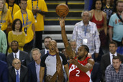Kawhi Leonard #2 of the Toronto Raptors attempts a shot against Draymond Green #23 of the Golden State Warriors in the first half during Game Six of the 2019 NBA Finals at ORACLE Arena on June 13, 2019 in Oakland, California. NOTE TO USER: User expressly acknowledges and agrees that, by downloading and or using this photograph, User is consenting to the terms and conditions of the Getty Images License Agreement.