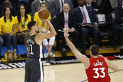 Klay Thompson #11 of the Golden State Warriors attempts a shot against Marc Gasol #33 of the Toronto Raptors in the first half during Game Six of the 2019 NBA Finals at ORACLE Arena on June 13, 2019 in Oakland, California. NOTE TO USER: User expressly acknowledges and agrees that, by downloading and or using this photograph, User is consenting to the terms and conditions of the Getty Images License Agreement.