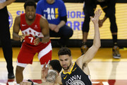 Fred VanVleet #23 of the Toronto Raptors gets tangled up with Klay Thompson #11 of the Golden State Warriors in the first half during Game Six of the 2019 NBA Finals at ORACLE Arena on June 13, 2019 in Oakland, California. NOTE TO USER: User expressly acknowledges and agrees that, by downloading and or using this photograph, User is consenting to the terms and conditions of the Getty Images License Agreement.
