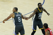Andre Iguodala #9 and Draymond Green #23 of the Golden State Warriors react against the Toronto Raptors during Game Six of the 2019 NBA Finals at ORACLE Arena on June 13, 2019 in Oakland, California. NOTE TO USER: User expressly acknowledges and agrees that, by downloading and or using this photograph, User is consenting to the terms and conditions of the Getty Images License Agreement.