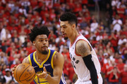 Quinn Cook #4 of the Golden State Warriors is defended by Danny Green #14 of the Toronto Raptors in the second half during Game Two of the 2019 NBA Finals at Scotiabank Arena on June 02, 2019 in Toronto, Canada.  NOTE TO USER: User expressly acknowledges and agrees that, by downloading and or using this photograph, User is consenting to the terms and conditions of the Getty Images License Agreement.
