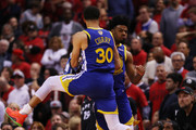 Quinn Cook #4 and Stephen Curry #30 of the Golden State Warriors celebrate the play against the Toronto Raptors in the second half against the Toronto Raptors during Game Two of the 2019 NBA Finals at Scotiabank Arena on June 02, 2019 in Toronto, Canada.  NOTE TO USER: User expressly acknowledges and agrees that, by downloading and or using this photograph, User is consenting to the terms and conditions of the Getty Images License Agreement.