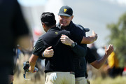 Captain Ernie Els of South Africa and the International team congratulates Hideki Matsuyama of Japan and the International team after Matsuyama and C.T. Pan of Taiwan and the International team defeated Webb Simpson of the United States team and Patrick Reed of the United States team 1up on the 18th green during Thursday four-ball matches on day one of the 2019 Presidents Cup at Royal Melbourne Golf Course on December 12, 2019 in Melbourne, Australia.