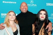 "Retransmission with alternate crop.). (L-R) Florence Pugh, Dwayne Johnson, and Paige attend the surprise screening of ""Fighting With My Family"" during the 2019 Sundance Film Festival at The Ray on January 28, 2019 in Park City, Utah."