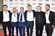 """(L-R) Nelson Piquet Jr., Sam Bird, Fisher Stevens, Alejandro Agag, Malcolm Venville and Jean Eric Vergne attend the """"And We Go Green"""" premiere during the 2019 Toronto International Film Festival at Ryerson Theatre on September 08, 2019 in Toronto, Canada."""