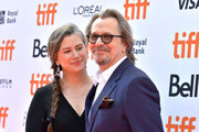 """(L-R) Gisele Schmidt and Gary Oldman attend """"The Laundromat"""" premiere during the 2019 Toronto International Film Festival at Princess of Wales Theatre on September 09, 2019 in Toronto, Canada."""