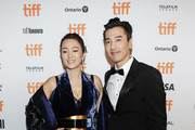 """Gong Li and Mark Chao attend the """"Saturday Fiction"""" premiere during the 2019 Toronto International Film Festival at Winter Garden Theatre on September 07, 2019 in Toronto, Canada."""