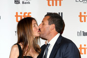 """Adam Sandler (R) and Jackie Sandler attend the """"Uncut Gems""""premiere during the 2019 Toronto International Film Festival at Princess of Wales Theatre on September 09, 2019 in Toronto, Canada."""