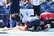 Kristina Mladenovic of France .is treated by the trainer during her Women's Singles first round match against Angelique Kerber of Germany during day one of the 2019 US Open at the USTA Billie Jean King National Tennis Center on August 26, 2019 in the Flushing neighborhood of the Queens borough of New York City.