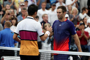 Kei Nishikori of Japan shakes hans after his Men's Singles second round match with Bradley Klahn of the United States on day three of the 2019 US Open at the USTA Billie Jean King National Tennis Center on August 28, 2019 in the Flushing neighborhood of the Queens borough of New York City.