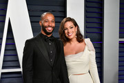 Justin Ervin (L) and Ashley Graham attend the 2019 Vanity Fair Oscar Party hosted by Radhika Jones at Wallis Annenberg Center for the Performing Arts on February 24, 2019 in Beverly Hills, California.