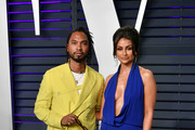 Miguel (L) and Nazanin Mandi attend the 2019 Vanity Fair Oscar Party hosted by Radhika Jones at Wallis Annenberg Center for the Performing Arts on February 24, 2019 in Beverly Hills, California.