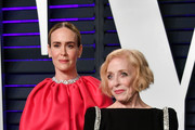 Sarah Paulson (L) and Holland Taylor attend the 2019 Vanity Fair Oscar Party hosted by Radhika Jones at Wallis Annenberg Center for the Performing Arts on February 24, 2019 in Beverly Hills, California.
