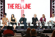 """(L-R) Noel Fisher, Emayatzy Corinealdi, Aliyah Royale, Noah Wyle, Caitlin Parrish, Erica Weiss, Sunil Nayar, and Sarah Schechter of the television show """"The Red Line"""" speak during the CBS segment of the 2019 Winter Television Critics Association Press Tour at The Langham Huntington, Pasadena on January 30, 2019 in Pasadena, California."""