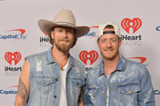 (EDITORIAL USE ONLY. NO COMMERCIAL USE) (L-R) Brian Kelley and Tyler Hubbard of Florida Georgia Line arrive at the 2019 iHeartCountry Festival Presented by Capital One at the Frank Erwin Center on May 4, 2019 in Austin, Texas.