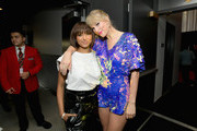 (EDITORIAL USE ONLY. NO COMMERCIAL USE) Kat Graham and Taylor Swift attend the 2019 iHeartRadio Music Awards which broadcasted live on FOX at Microsoft Theater on March 14, 2019 in Los Angeles, California.