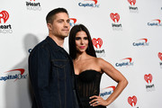 (EDITORIAL USE ONLY) (L-R) Eric Winter and Roselyn Sánchez attend the 2019 iHeartRadio Music Festival at T-Mobile Arena on September 21, 2019 in Las Vegas, Nevada.