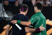 Novak Djokovic of Serbia embraces Roger Federer of Switzerland after their Men's Singles Semifinal match on day eleven of the 2020 Australian Open at Melbourne Park on January 30, 2020 in Melbourne, Australia.