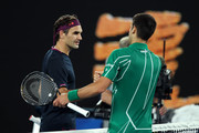 Novak Djokovic of Serbia shakes hands with Roger Federer of Switzerland after their Men's Singles Semifinal match on day eleven of the 2020 Australian Open at Melbourne Park on January 30, 2020 in Melbourne, Australia.